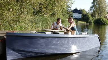 Noise and fume free boats exhibit Kebony wood starboard, table and decking